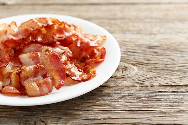crispy-strips-of-bacon-on-a-grey-wooden-background