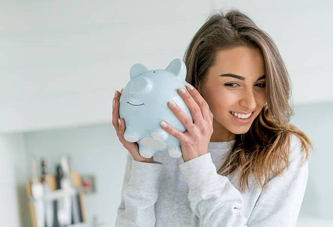 happy-woman-saving-money-in-piggybank