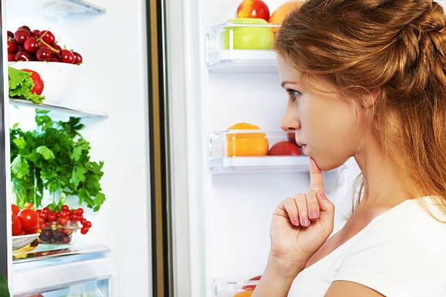 woman-and-open-refrigerator-with-fruits-vegetables