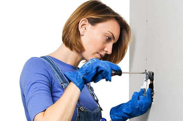 woman-installing-light-switch