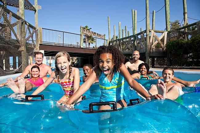 smiling-group-at-water-park-in-innertubes