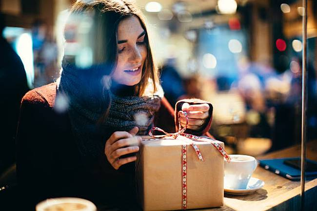 young-beautiful-woman-opening-gift-present