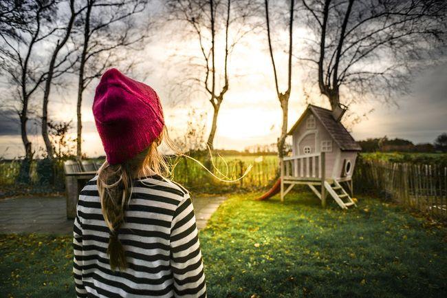 child-girl-playhouse-backyard